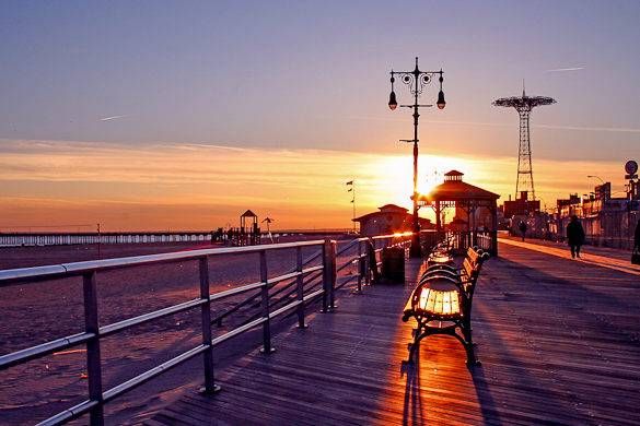 Coney Island boardwalk at Sunset with Parachute Jump in the background