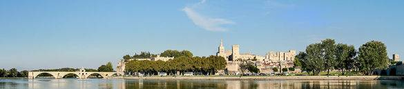 A panorama of the city of Avignon: Pont d'Avignon can be seen to the left and the Rhône River in the foreground