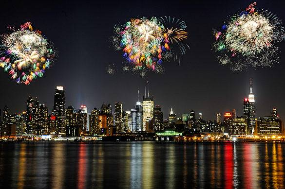 Fireworks light up the sky above Manhattan, NYC in this picture taken from New Jersey