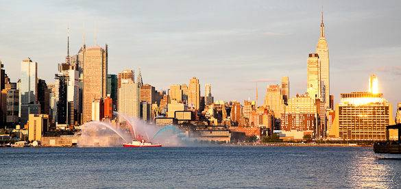 Picture of a FDNY fireboat spraying patriotic colors high above the Hudson River in New York on July 4th
