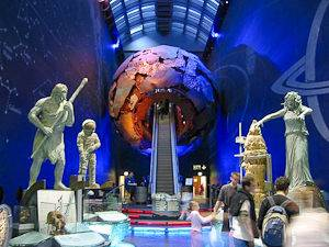 An image of sculptures of the earth and a large globe at the London Natural History Museum