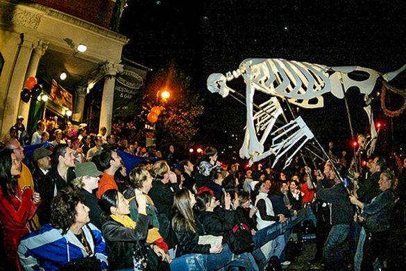 Picture of a spooky puppet hovering over a crowd at New York City's Village Halloween Parade