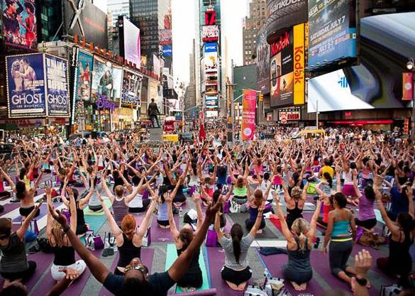 Picture of people practicing yoga in Times Square