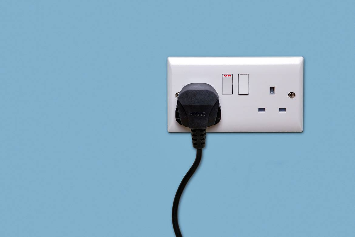 Photo of a three-pin plug.