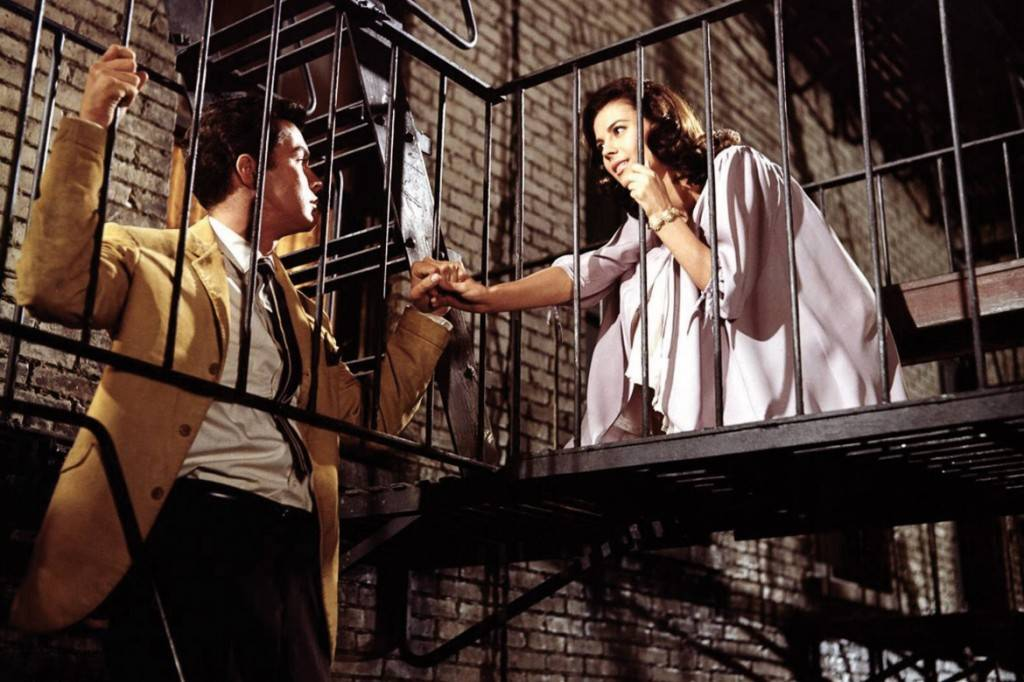 Image of still from West Side Story with Marie and Tony on a fire escape