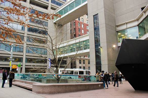 Image of the Hunter College campus with students walking