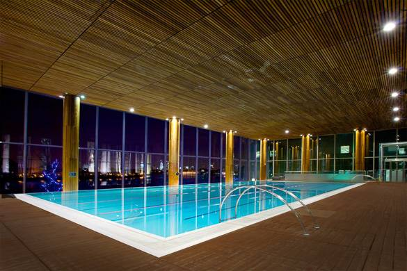 Image of the pool of the London Virgin Active gym club with the skyline in the background