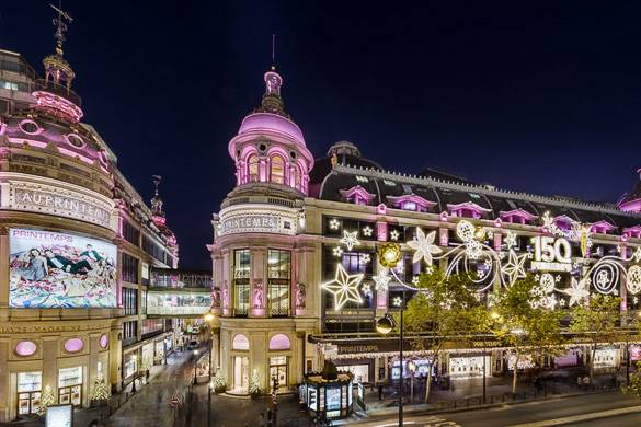 Image of Paris department store Printemps with pink and white Christmas lights outside