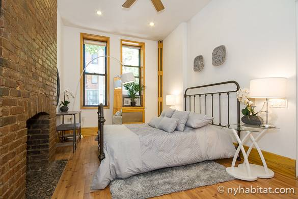 Image of bedroom of NY-16922 in the East Village with decorative brick fireplace