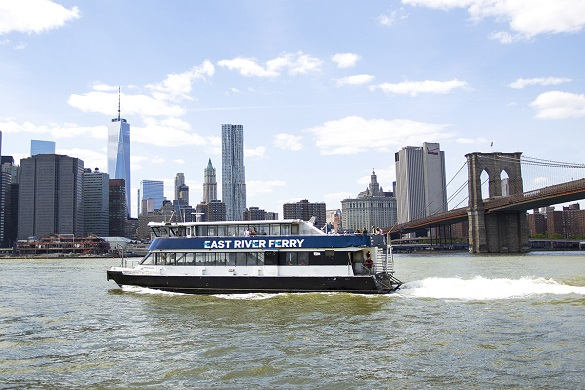 Image of the East River Ferry near the Brooklyn Bridge with the Manhattan skyline in the background