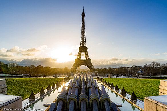 Image of Eiffel Tower with sun setting behind it