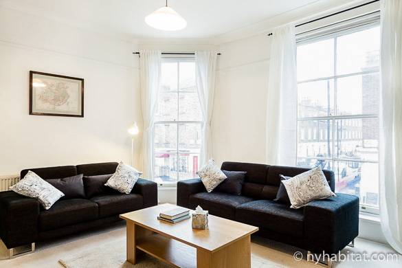 Image of living room of LN-1080 in Paddington with windows overlooking the street