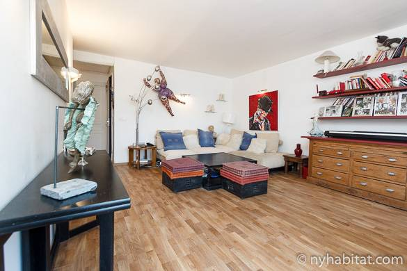 Image of living room of apartment PA-1985 with artwork and wood floors in Pigalle