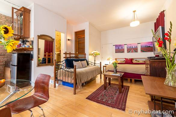 Image of studio vacation rental NY-11966 in the East Village with fall colors and flowers