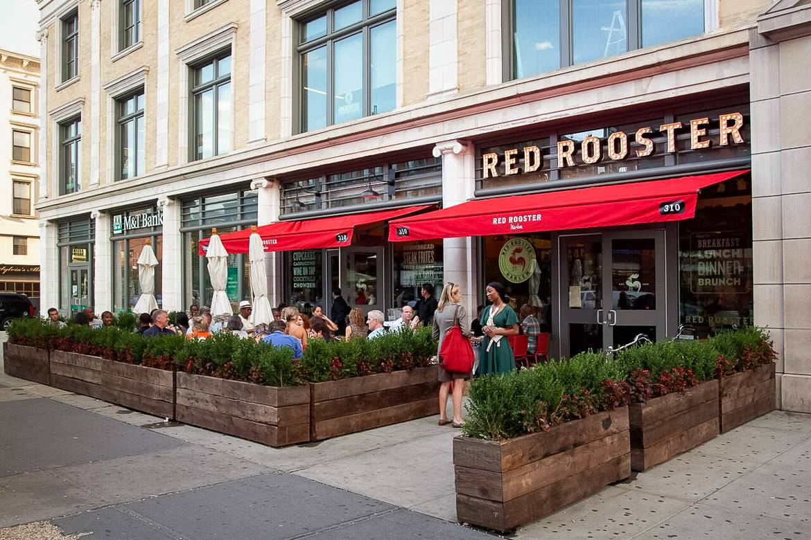 Image of the outside seating area of Red Rooster in Harlem