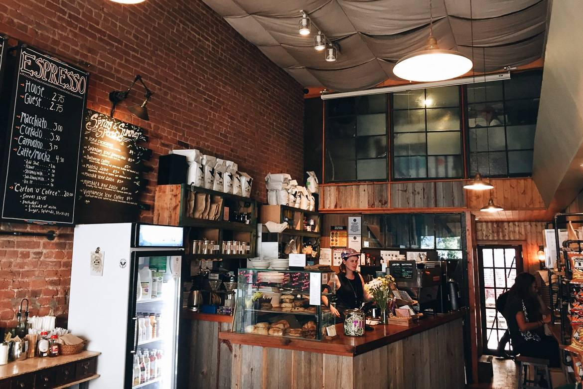 Image of Daily Press coffee shop with barista at the counter