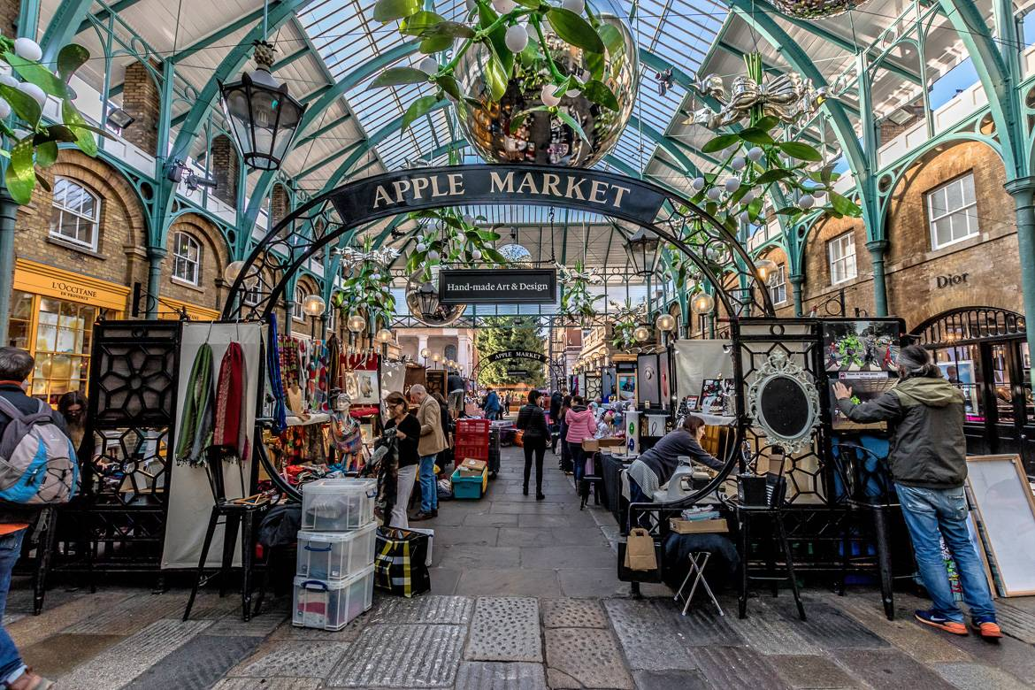 """Image of market in Covent Garden with sign saying """"Apple Market"""""""