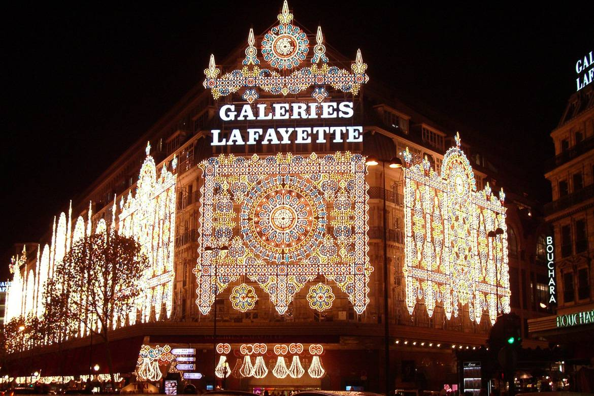 Image of the outside of Galeries Lafayette shopping center in Paris with Christmas lights