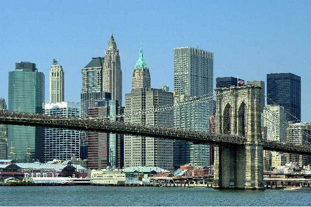 Brooklyn Bridge from the East River with views of downtown Manhattan photo