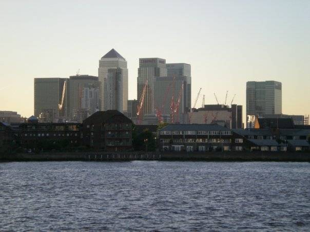 Sitting by the Dock of the Thames: Canary Wharf, London