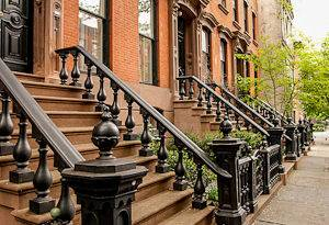 Image of brownstone houses in Harlem, New York City