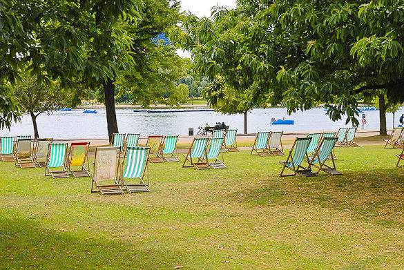 An image of a lawn with deck chairs in London's Hyde Park