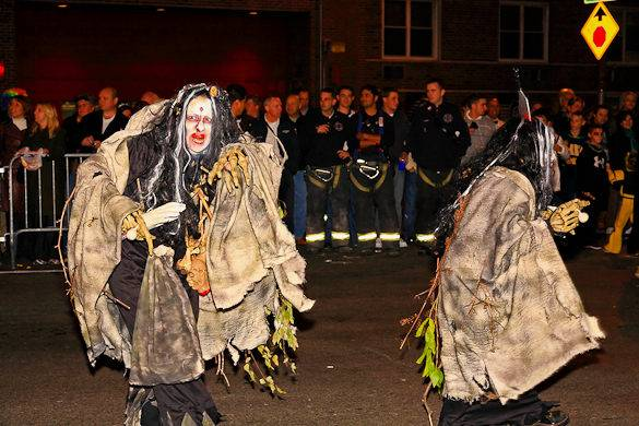 Image of two people dressed up as witches for New York City's Halloween Parade