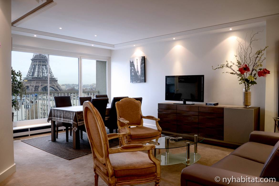 Image of the living room of a Champ de Mars 2-bedroom apartment with a view of the Eiffel Tower