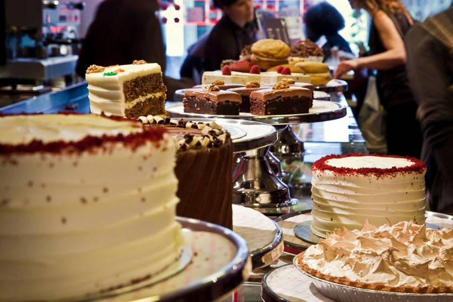 Image of countertop filled with cakes and pastries