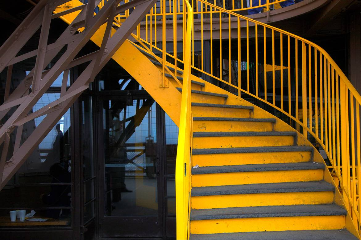 Eiffel Tower stairs in yellow
