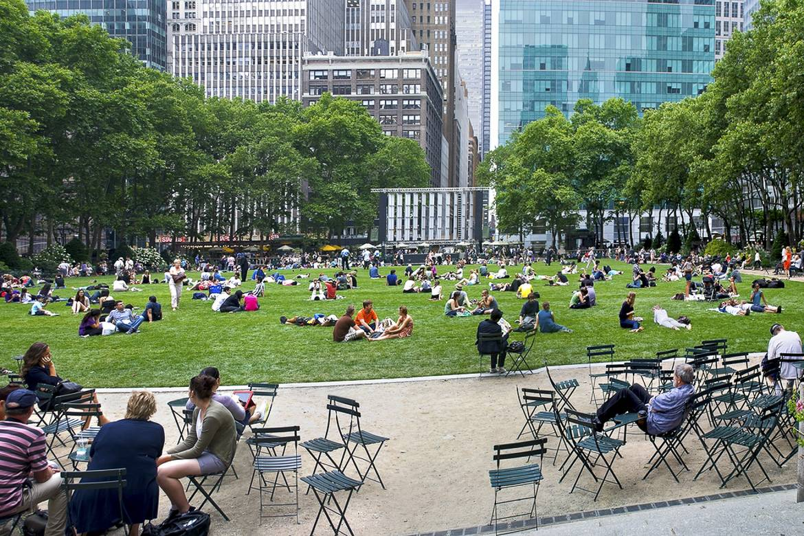 Eager movie-goers gather on the lawn at Bryant Park for outdoor screenings.