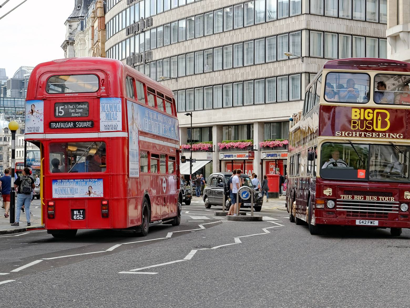 Image of two double-decker buses on a London street