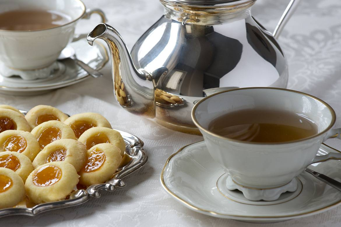 Image of traditional English afternoon tea with cookies, teacup, saucer and teapot