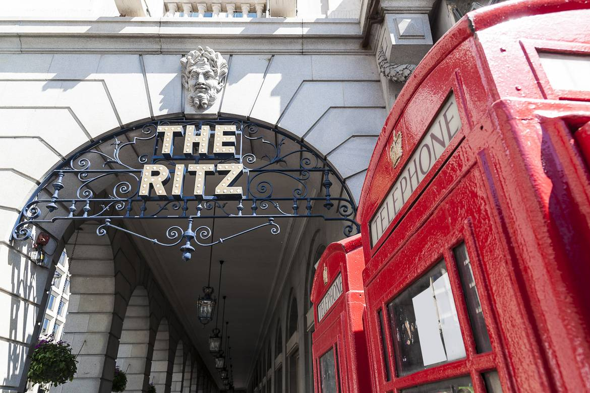 Image of a red telephone booth outside the entrance to the Ritz London