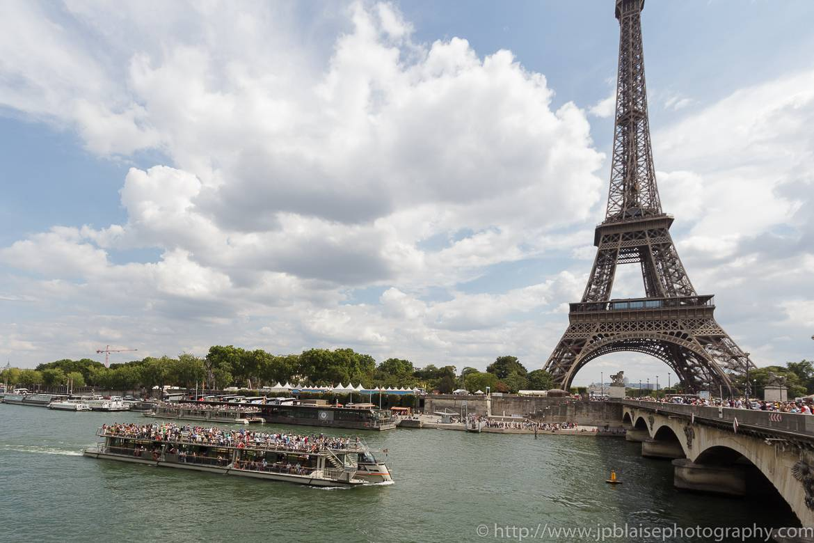 Image of a bateau mouche (tourist boat) on the Seine River by the Eiffel Tower