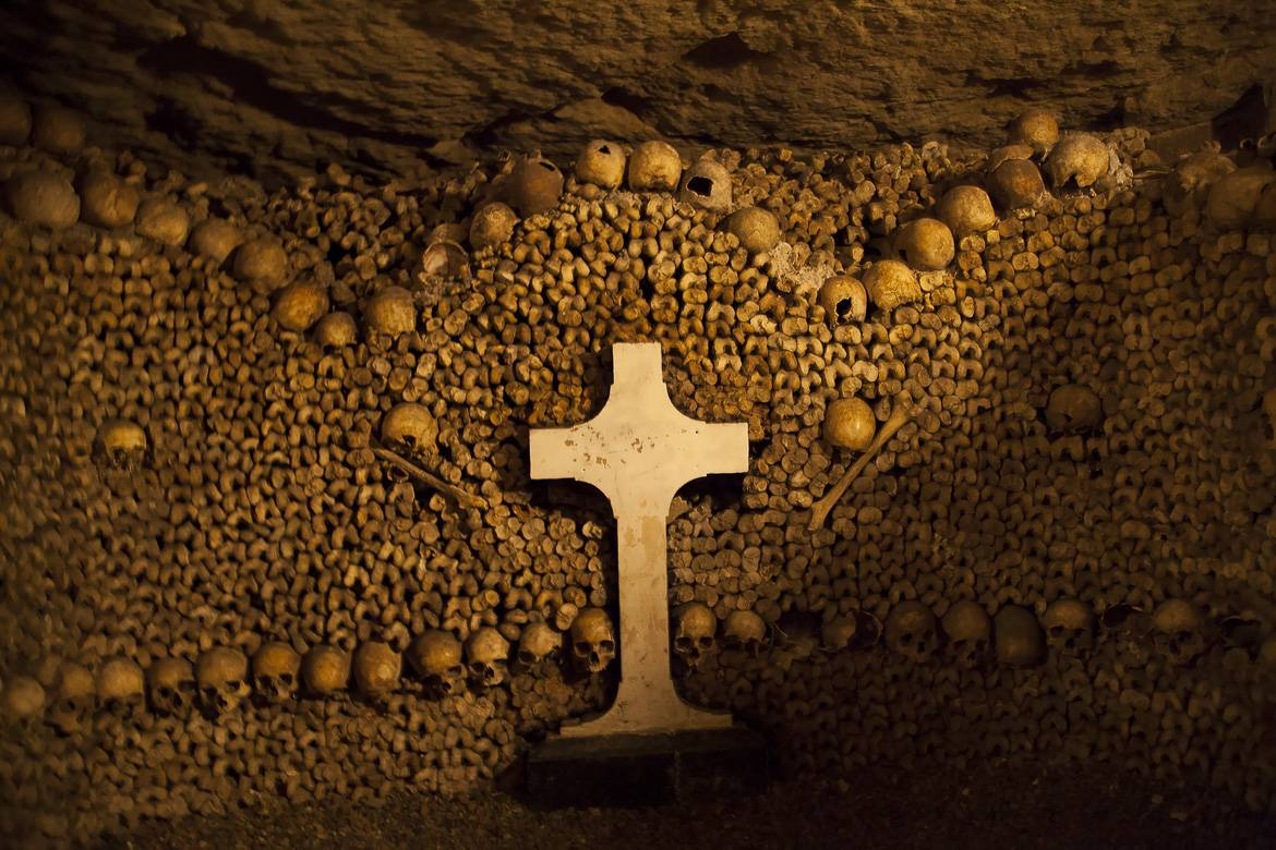 Image of the Catacombs in Paris, with human remains arranged into sculptures