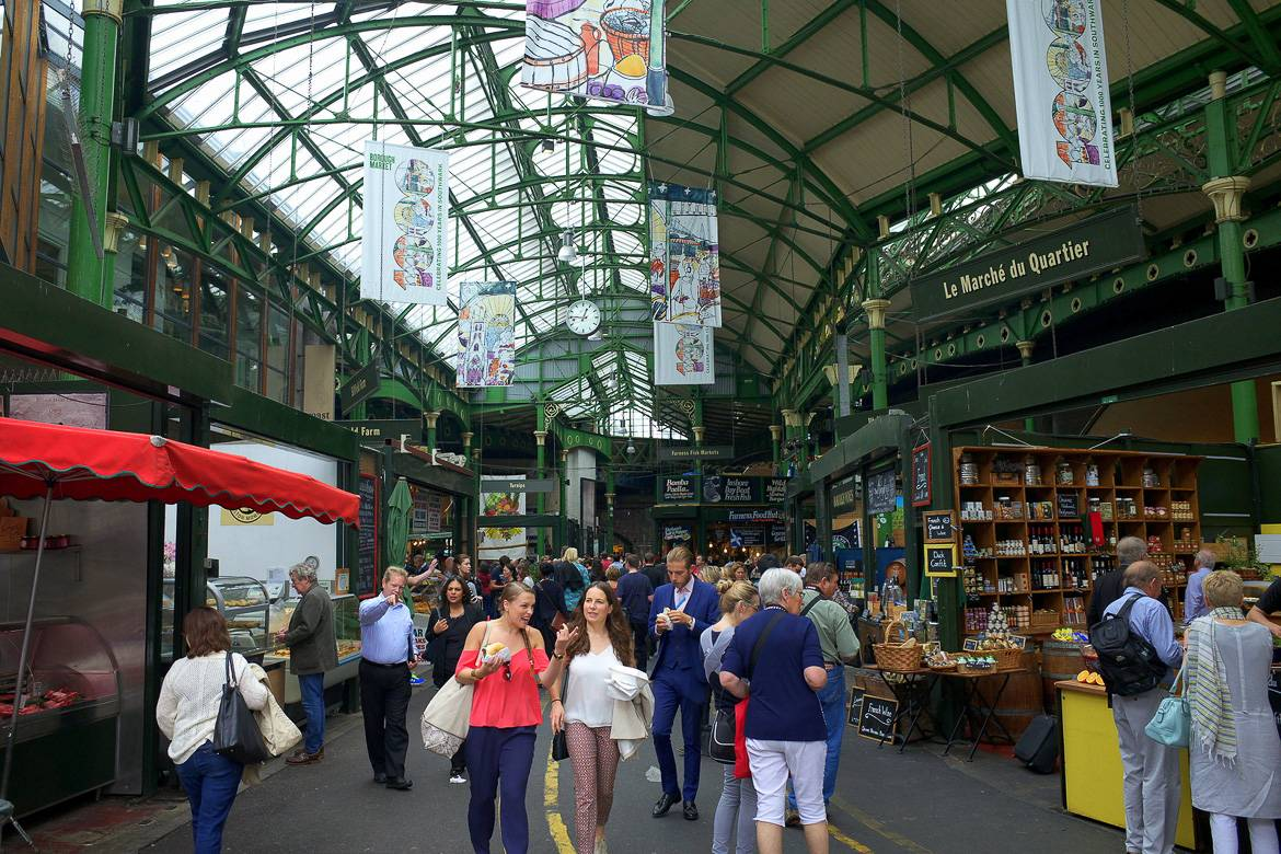Image of people walking through the open-air Borough Market