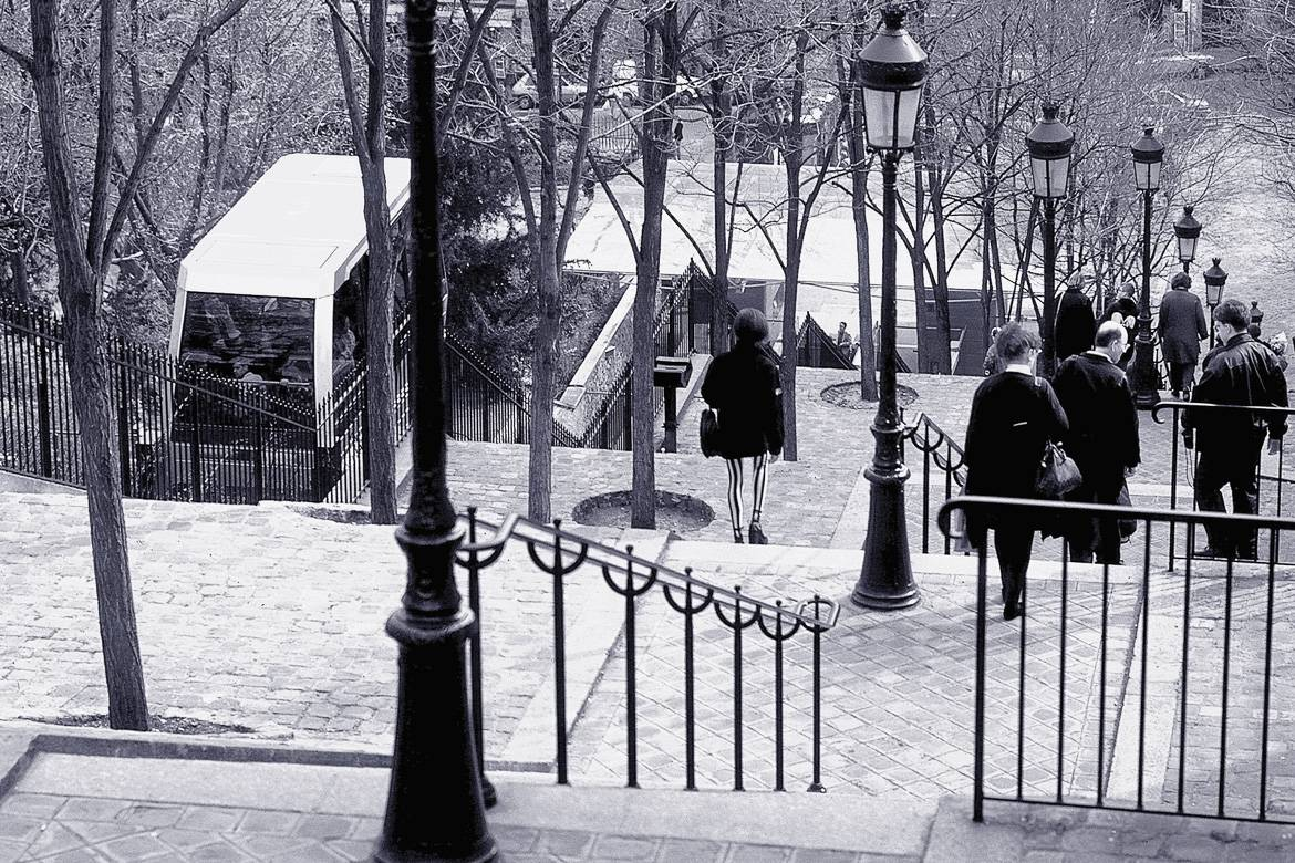 Image of the stairs and funicular train up to Montmartre in black and white