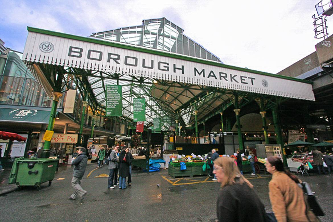 Image of Borough Market with several people walking into it