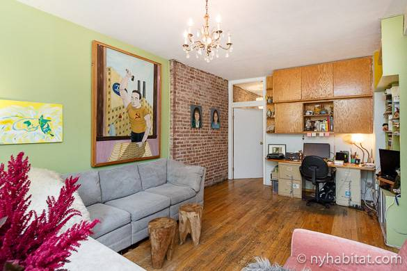 Image of living room of NY-16533 with colorful walls and chandelier