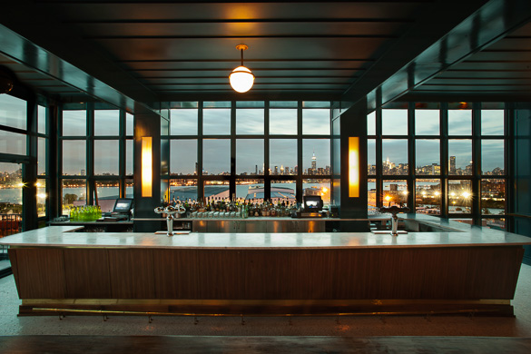 Image of the Wythe Hotel bar with Manhattan view