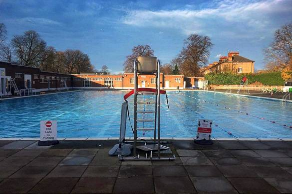 Image of the Brockwell Lido swimming pool, half in shade