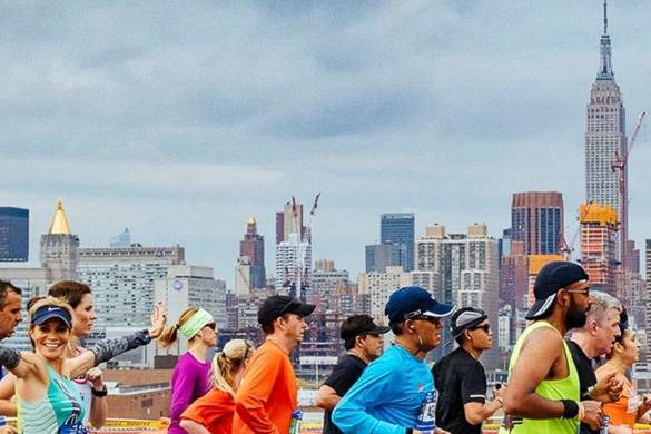 Image of runners in front of the NYC skyline