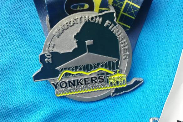 Image of a runner with a Yonkers Marathon pin