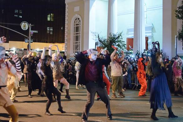Image of people dressed in costumes dancing in the Village Halloween parade