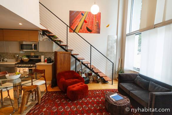 Image of living room of NY-15911 with staircase and wall of windows