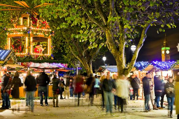 Image of Christmas Market at the Tate at night with holiday lights and people