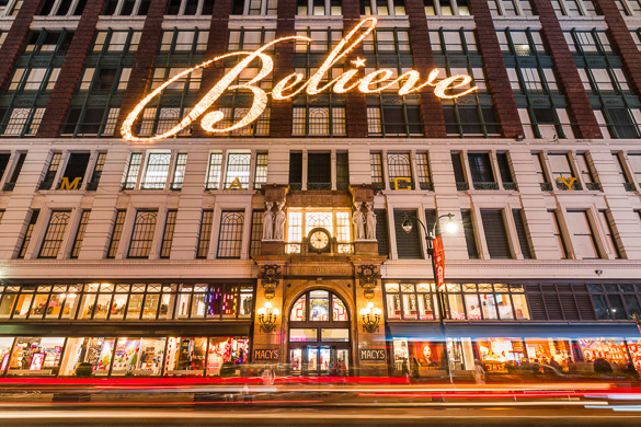 """Image of the facade of Macy's Herald Square with the word """"Believe"""" in lights"""