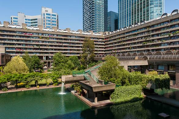Image of the view of two wings of the Barbican Centre, with a pond in the foreground