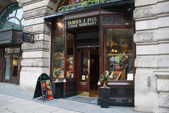 Image of the display windows of James J Fox, a cigar merchant